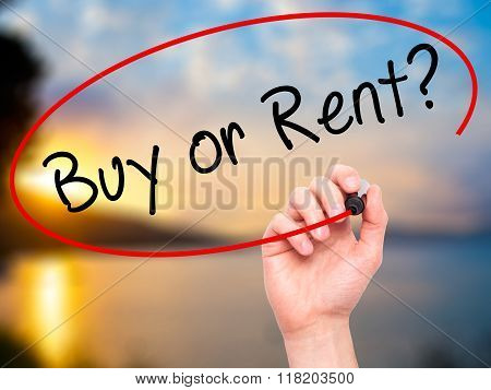 Man Hand Writing Buy Or Rent? With Black Marker On Visual Screen
