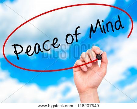 Man Hand Writing Peace Of Mind Black Marker On Visual Screen