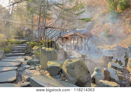 Outdoor Hot Spring With Stone Walking Path, Onsen In Japan In Autumn