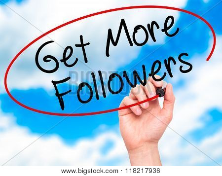 Man Hand Writing Get More Followers With Black Marker On Visual Screen