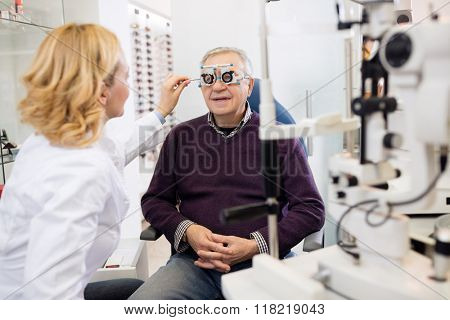 Optic specialists views eyesight to patient in eye clinic