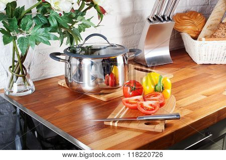 tomatoes on a wooden board knife kitchen countertops, interior, pan, hob, cooker