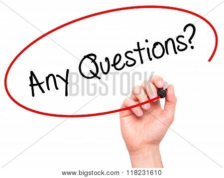Man Hand Writing Any Questions? With Black Marker On Visual Screen