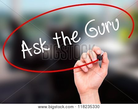 Man Hand Writing Ask The Guru With Black Marker On Visual Screen