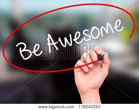 Man Hand Writing Be Awesome With Black Marker On Visual Screen