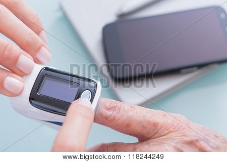 Doctor Hands With Finger Pulse Oximeter