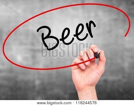 Man Hand Writing Beer With Black Marker On Visual Screen