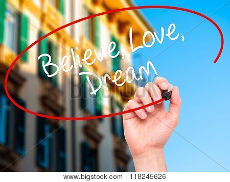 Man Hand Writing Believe Love Dream With Black Marker On Visual Screen