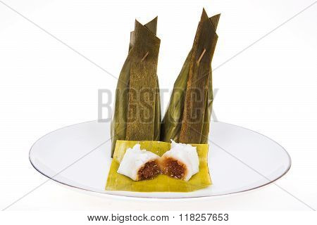 Thai dessert . Streamed flour coconut filling recipes Khanom Sod-Sai ingredient coconut with banana leaves wrapped