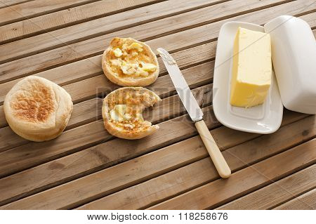 Buttered Crumpets With A Pat Of Farm Butter