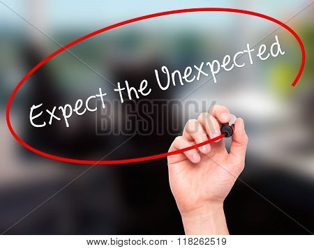 Man Hand Writing Expect The Unexpected With Black Marker On Visual Screen