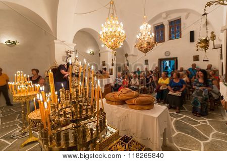 Mass In A Greek Orthodox Church In Island Ios, Greece. On Account Of Birth Of Mary, Mother Of Christ
