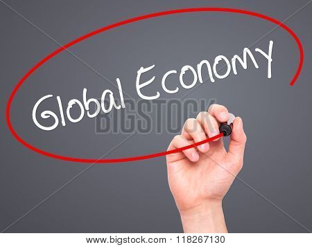 Man Hand Writing Global Economy With Black Marker On Visual Screen