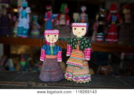 Handicraft puppets in ethnic minority traditional custume are sold in Bac Ha market, Laocai, Vietnam poster