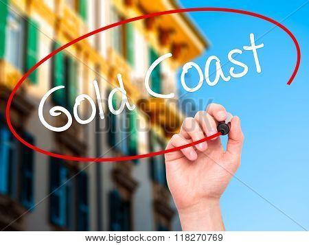 Man Hand Writing Gold Coast With Black Marker On Visual Screen