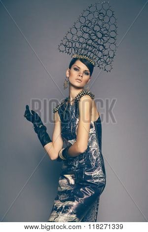 Woman in headwear with spikes