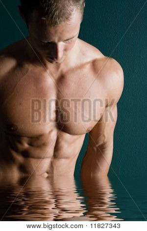Sexy muscular man in spa