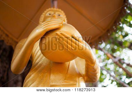 Stand Golden Buddha Statue In Thailand