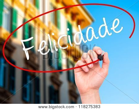 Man Hand Writing Felicidade (happiness In Portuguese) With Black Marker On Visual Screen