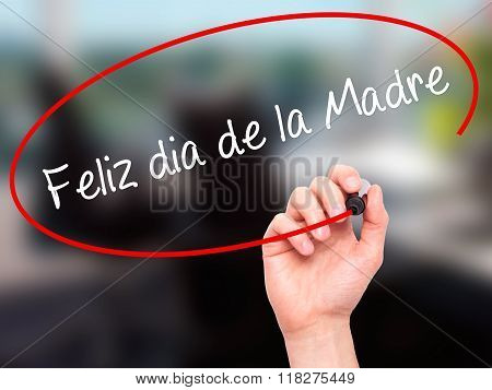 Man Hand Writing Feliz Dia De La Madre (happy Mothers Day In Spanish)  With Black Marker On Visual S