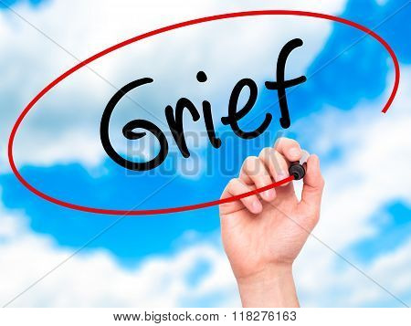 Man Hand Writing Grief With Black Marker On Visual Screen