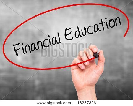 Man Hand Writing  Financial Education With Black Marker On Visual Screen