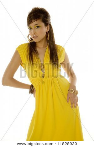 Gorgeous young Asian woman in yellow dress