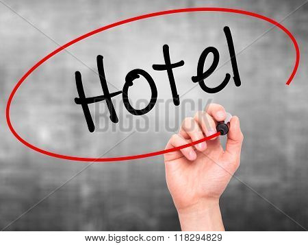 Man Hand Writing Hotel With Black Marker On Visual Screen