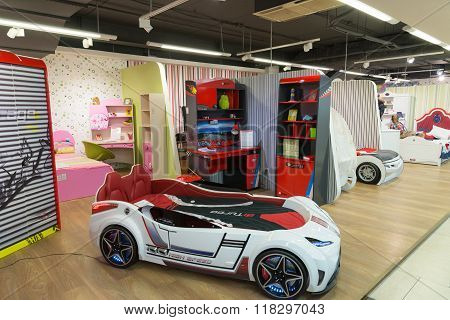 Khimki, Russia - February 13. 2016. Children's bed in the form of auto in Grand Furniture shopping, largest specialty shop.