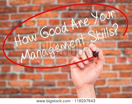 Man Hand Writing How Good Are Your Management Skills? With Black Marker On Visual Screen