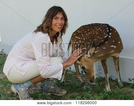 Woman Strokes Deer