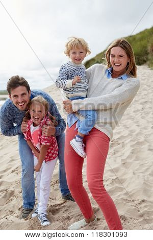 Portrait Of Family Having Fun On Beach Together
