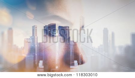 Close-up portrait of young woman. Double exposure city on background, visual effects