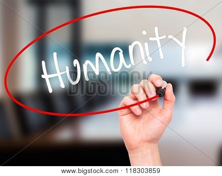 Man Hand Writing Humanity  With Black Marker On Visual Screen