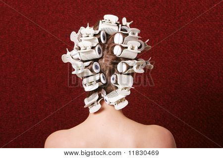 Hair rollers in woman's hair