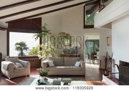 Interior; living room of a rustic house; divan and armchair
