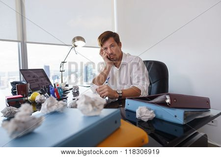 Portrait Sad Business Man Trying To Write Paper Letter