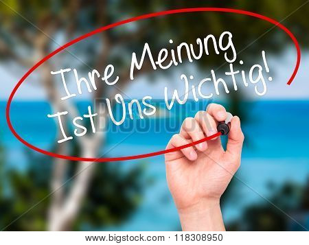 Man Hand Writing Ihre Meinung Ist Uns Wichtig! (your Opinion Is Important To Us In German) With Mark