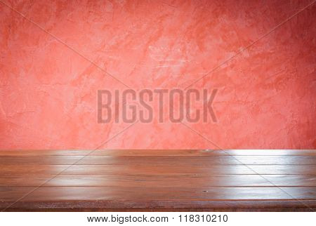 Old Empty Wooden Table Top With Red Wall Background