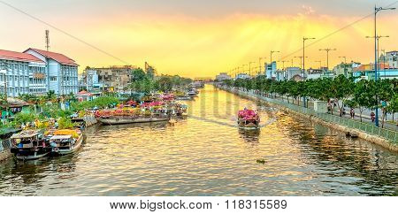 Boats on river wave flowers turn rays sunset
