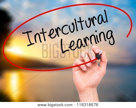 Man Hand Writing Intercultural Learning With Black Marker On Visual Screen