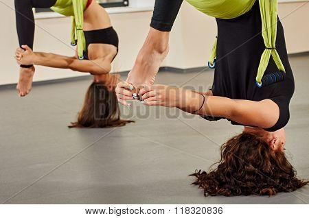Antigravity yoga exercise. upside down