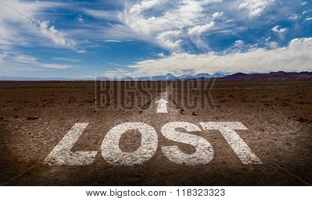 Lost written on desert road