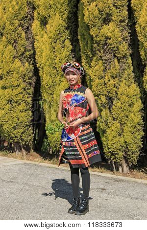 Kunming, China - January 7, 2016: Young Girl Dressed With The Traditional Attire Of Yunnan, In China