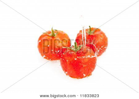 Tomatoes Under Running Water Isolated On White
