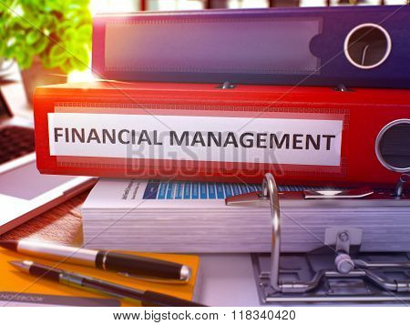 Financial Management on Red Office Folder. Toned Image.