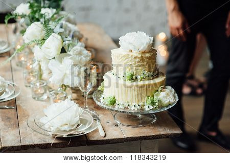 Wedding Cake Decorated Loft Style With A Table And Accessories