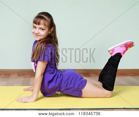 Cute Girl  In Violet Sports Costume Is Bending At The Waist, Smiling