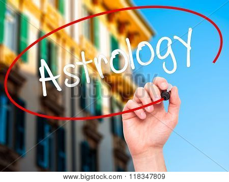 Man Hand Writing Astrology With Black Marker On Visual Screen