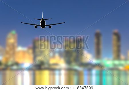 Night (dawn, dusk ) flight of the airplane (jet) over the beautiful night sky and city over ocean.